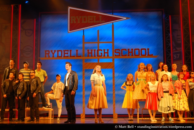 Rob Mills (Danny) and Gretel Scarlett (Sandy) with the cast of Grease the Musical